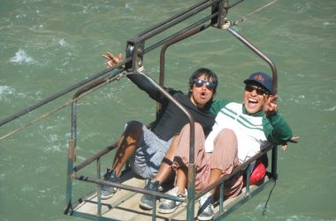 Walter and Hebert Crossing the River on an Oroya