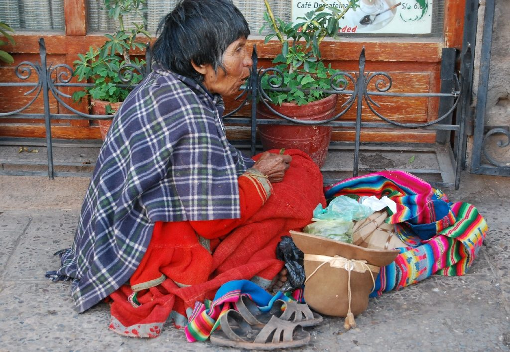 A Beggar Chewing Coca Leaves on the Corner of the Sol Avenue