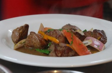 Perfectly Cooked Beef with Vegetables and Sauce of Lomo Saltado