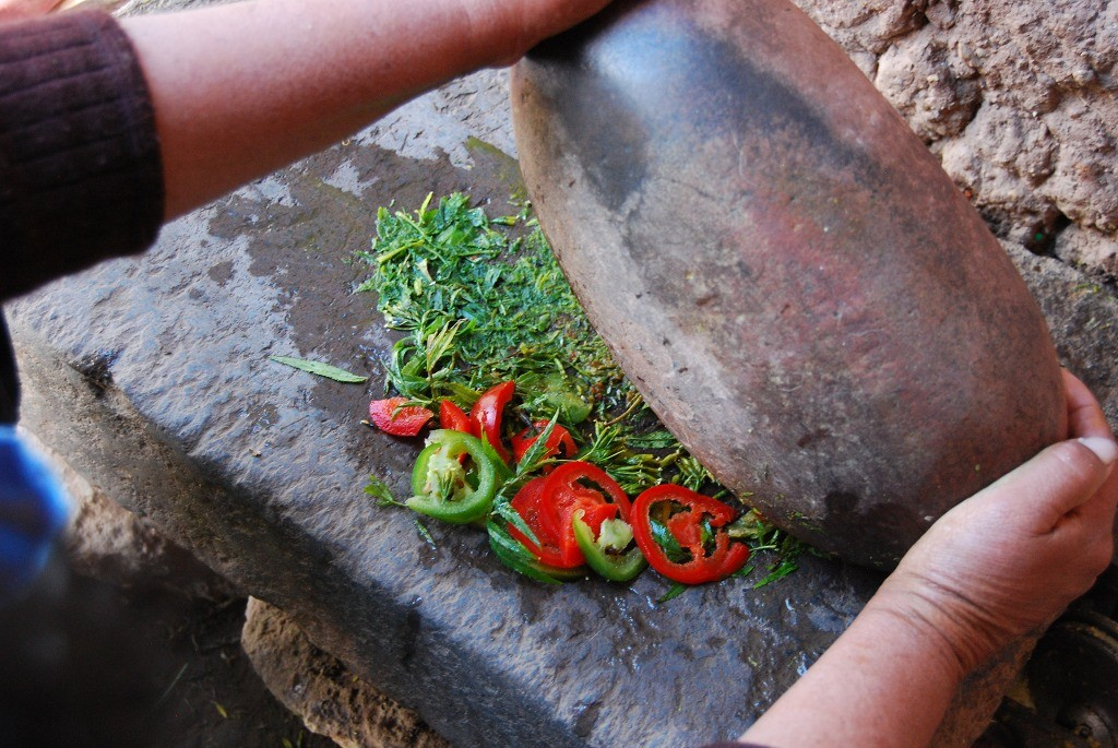 Grinding Hot Sauce on a Traditional Batán (Walter Coraza Morveli)