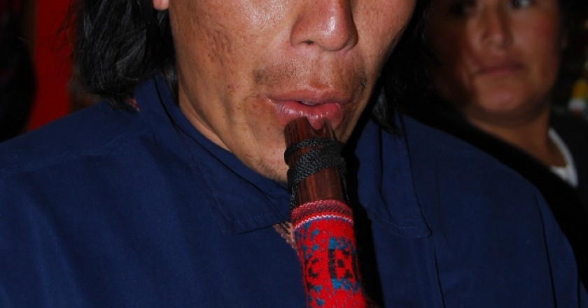 A Men Playing the Andean Quena