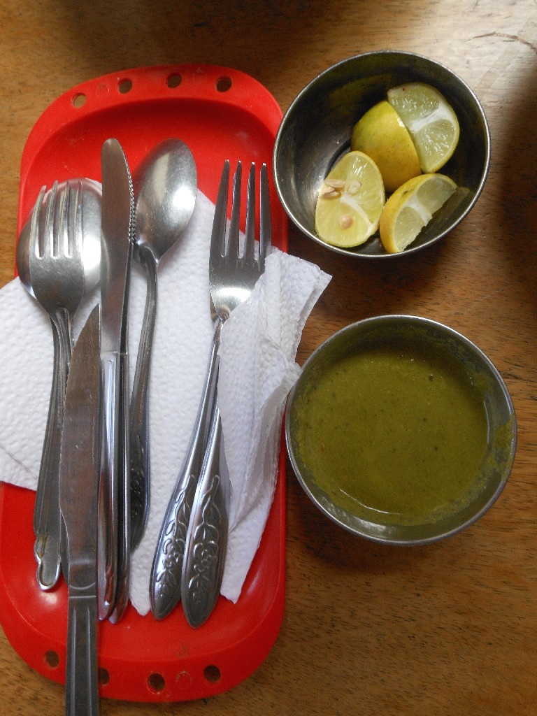 Silverware, Uchukuta (Hot Sauce) and Limes