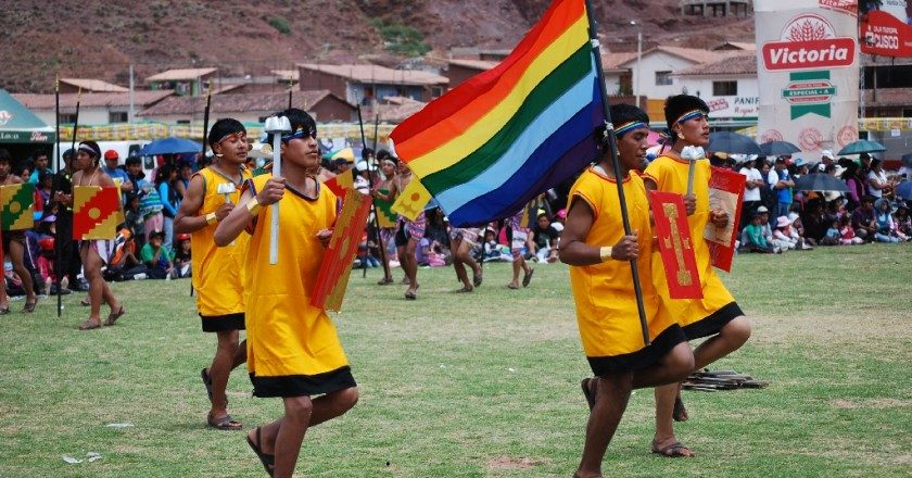 Young Men Carrying the Flag of Tawantinsuyo with Pride