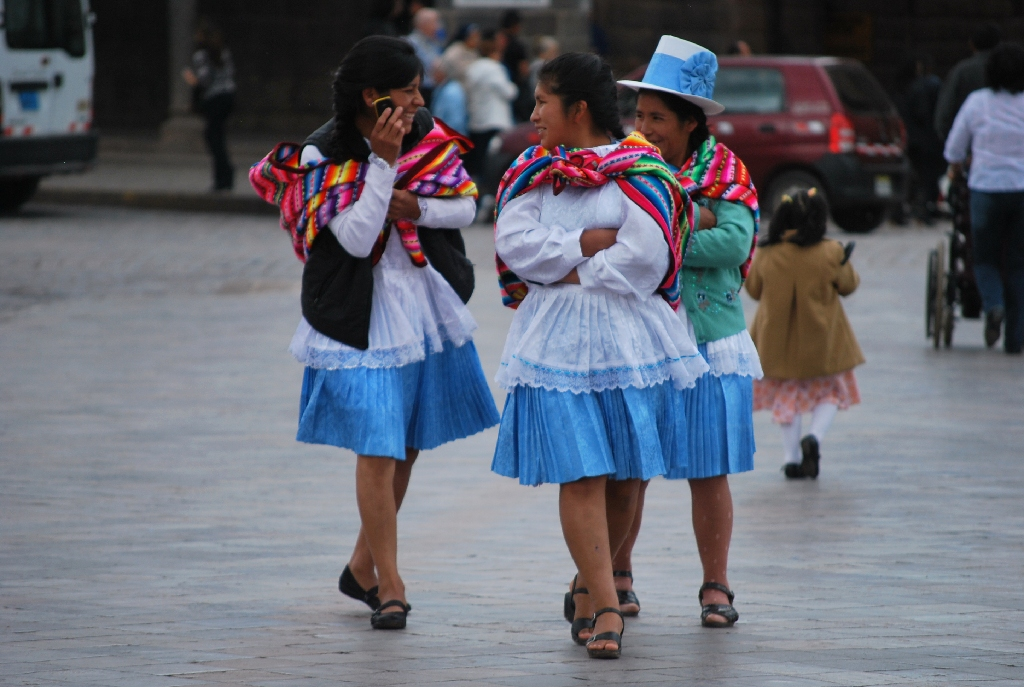 Beautiful Women with Colorful Dresses Walking Down the Plaza de Armas