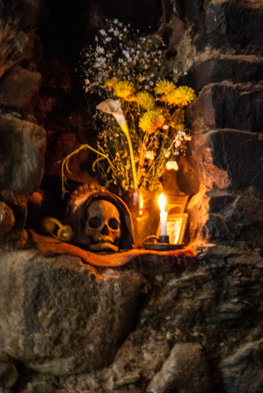 Offering of Candle and Flowers for Skull at Home (Photo: Walter Coraza. M)