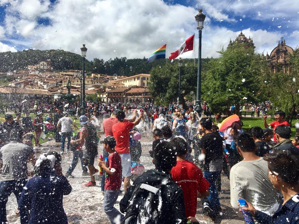 Playing with water in the plaza of Cusco