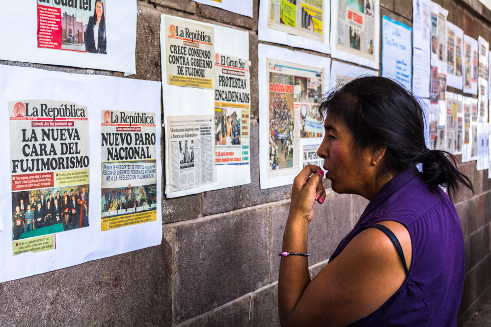 Reading Headlines on the Information Wall of the Paraninfo (Hebert Huamani)