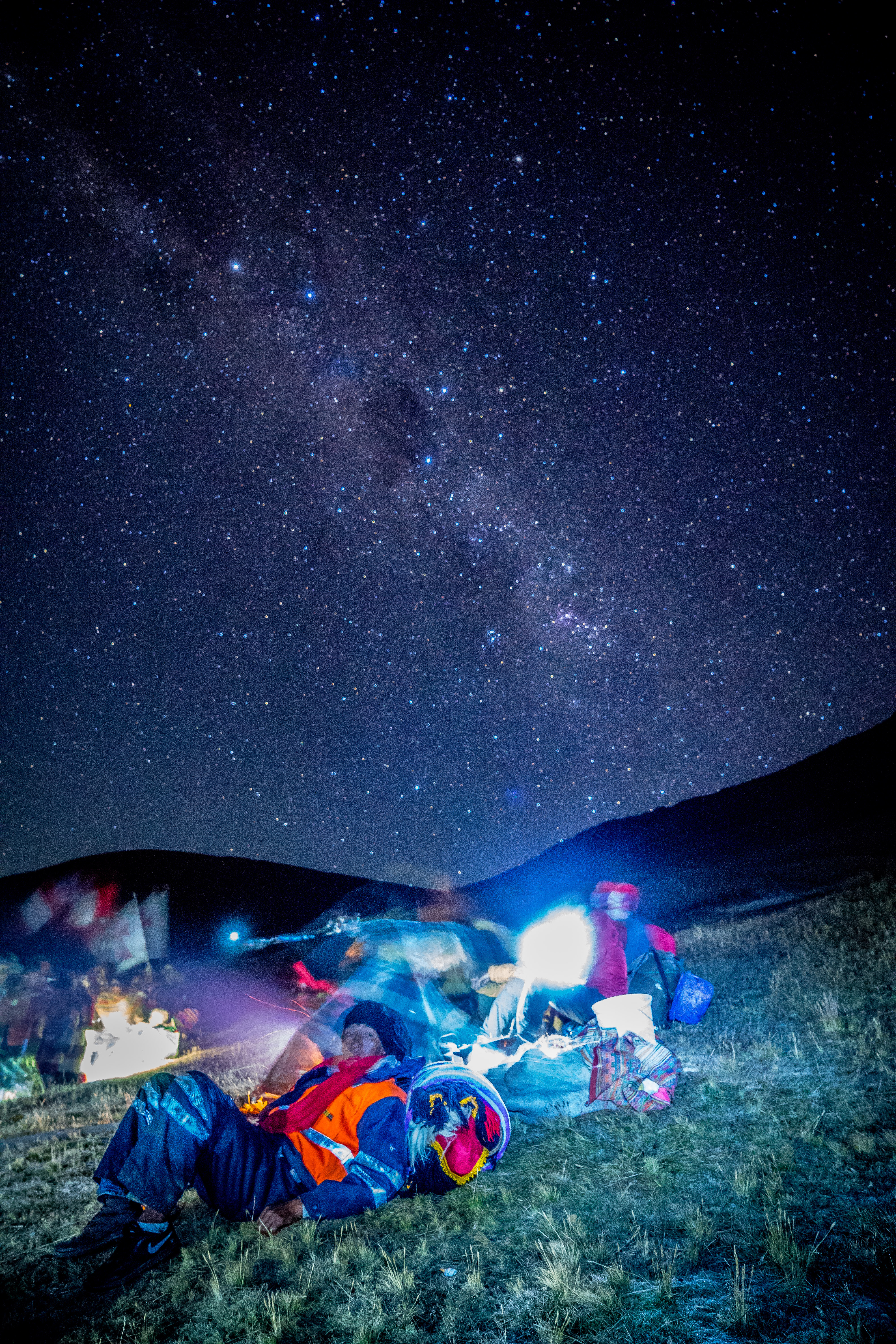 A Pablito Dancer taking a rest while walking under the milky way (Photo by Walter Coraza Morveli)