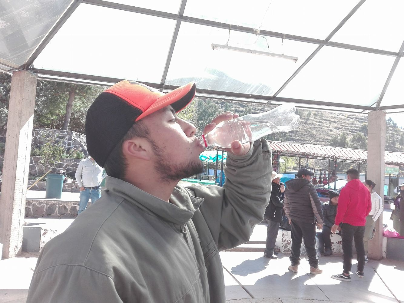 A Young Man Drinking the Medicinal Water (Photo: Brayan Coraza Morveli)